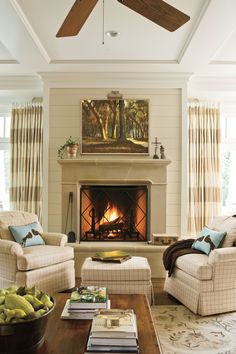 We have the perfect living room decor inspiration for you. What do you think of this living room idea? Local artwork is a meaningful accessory. A locally painted scene of Florida live oaks hangs above this family room's cast-stone fireplace. Cast Stone Fireplace, Fireplace Mantle, Living Room With Fireplace, Fireplace Design, Fireplace Ideas, Wall Fireplaces, Sandstone Fireplace, Classic Fireplace, Stone Mantel