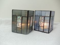 Dichroic glass and reed glass copper foiled to make candle shelters.