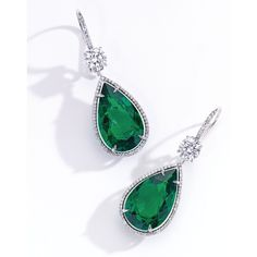 Pair of Platinum, 18 Karat White Gold, Emerald and Diamond Earrings. Suspending two pear-shaped emeralds weighing 8.13 and 8.06 carats, suspended from two round diamonds, each weighing .90 carat, further set with .85 carat of small round diamonds.