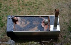 SOAK is an outdoor hot tub that can be heated by both wood fire and propane heating!