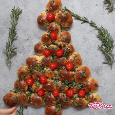 Christmas Tree Pull Apart is a delicious appetizer recipe made with a few simple ingredients: biscuit dough, butter, fresh herbs and cherry tomatoes. It's perfectly easy and festive to make for a holiday party and a. Christmas Party Food, Xmas Food, Christmas Cooking, Christmas Desserts, Holiday Treats, Christmas Treats, Holiday Parties, Christmas Party Appetizers, Christmas Lunch Ideas