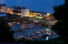 Night Panorama of Dover Harbour Board's Harbour House and Wellington Dock, Dover Marina, Kent, England. Panorama from the St Martin's Battery ruins of Harbour House and part of Dover Marina Hotel; the Victorian Fairbairn Crane, the non-tidal Wellington Dock, and Dover Sea Sports Centre and Hythe Bay Seafood Restaurant. Also the Western Promenade Kiosk, Beach and Seafront. Waterloo Crescent. Listed buildings. Dover Harbour. More information at http://www.panoramio.com/photo/79848159