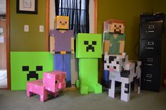 Made Minecraft figures out of cardboard boxes and construction paper.