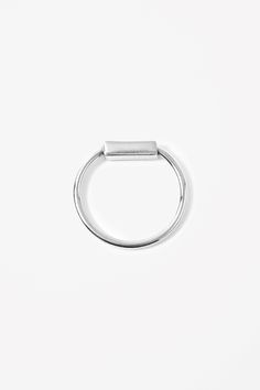 Made from sterling silver with a protective rhodium finish, this simple ring has a rectangular-shaped bead. Jewelry Accessories, Jewelry Design, Quality Diamonds, Metal Bracelets, Simple Jewelry, Pearl Bracelet, Sterling Silver Rings, Diamond Engagement Rings, Bling