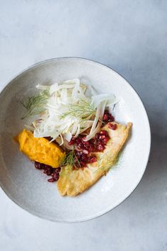 Fried plaice with pumpkin purée and roasted pomegranate :: Photography by Filipe Lucas Frazão