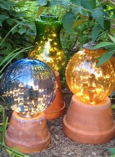 Terra Cotta Clay Pot DIY Project for Your Garden Garden lights made from flower pots and old lamp globes with strings of white lights in the globes.Garden lights made from flower pots and old lamp globes with strings of white lights in the globes.