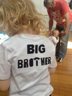 Back view - Marcus wearing his Big Brother Chevron Moustache T.