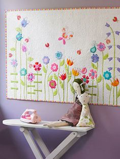 Hang this adorable decoration in your kid's room—courtesy of Whip Up Mini Quilts