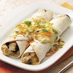 Makeover Chicken Cheese Enchiladas.  Still a lot of calories.  Try adding a veggie to filling and less cheese.