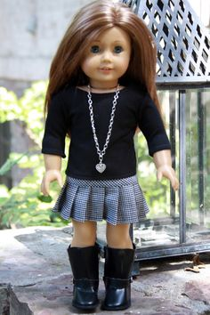 A classic houndstooth pleated skirt and black tee for your American Girl or other 18 inch doll. Get a matching outfit for you and your doll with Avanna Girl.