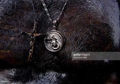 Stock Photo : Religious icons being worn around man's neck