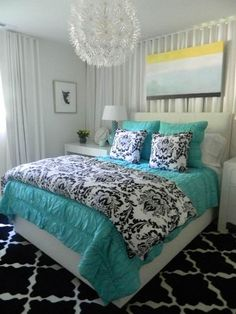 Beautiful Bedroom with Turquoise Bedding and Accents by melissa findley