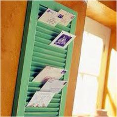 Mail sorter/ holder made out of an old shutter