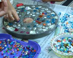 DIY stepping stones, using junk like buttons, chain, beads, broken plates, glass, shells, even coins from places you have been. Doing these :)