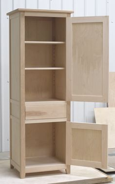 Small larder cupboard before painting. Solid maple carcass construction with birch ply panels and shelves. Oak dovetailed drawers and oak cornice.