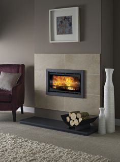 inset stove with stone surround Inset Fireplace, Wood Burner Fireplace, Wood Burning Fireplace Inserts, Fireplace Tile Surround, Small Fireplace, Bedroom Fireplace, Fireplace Remodel, Modern Fireplace, Living Room With Fireplace