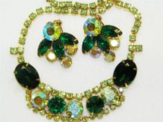 Vintage rhinestone bib necklace with coordinating Coro earrings. True vintage costume jewelry from the 1950's - 1960's era. Rich green tones of faceted glass rhinestones. Elegant married set.
