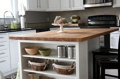 end shelves, butcher block top & seating added to existing kitchen island. looks great!