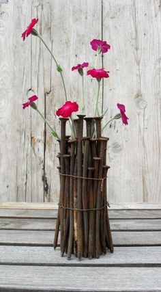 Rusty nails & wire Flower Vases.