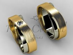 Ouro Branco e Ouro Amarelo 18k / 750 Diamante de 10 pontos. Lapidação brilhante. Largura 8,5 mm. Peso aproximado do par 23 gramas