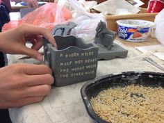 Use alphabet noodles to stamp writing in clay. The noodles just burn away in the kiln.