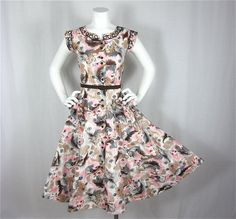 50s dress; browns, gray, and pink.