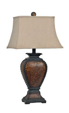 Studded Leather Lamp. This lamp is uniquely masculine with an elegant silhouette. Tooled leather is finished with bold edges ideal for lodge looks.