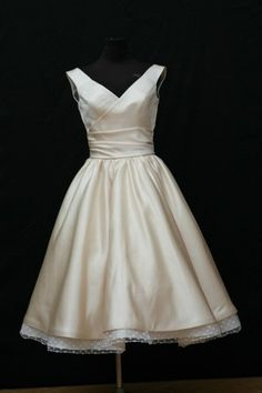 combines shorter style you're liking with a nice neckline and straps for you.  Polka dot under skirt is cute too!
