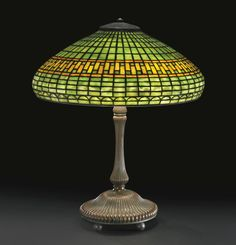 "TIFFANY STUDIOS ""GEOMETRIC"" TABLE LAMP circa 1910 23 1/8  in. (58.7 cm) high 19 1/4  in. (48.9 cm) diameter of shade Estimate  18,000 — 24,000"