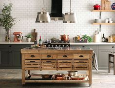 A kitchen carefully curated for function and beauty. I love the island from Williams Sonoma Napa Collection.