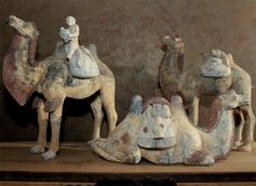 Chinese Tang Dynasty Painted Pottery Camels | From a unique collection of antique and modern antiquities at http://www.1stdibs.com/furniture/asian-art-furniture/antiquities/