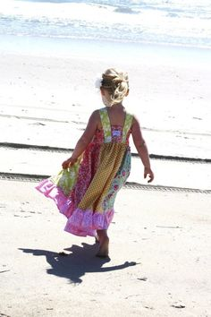 Adorable! Cute, flowing dresses at the beach....just how I'd want my daughter to be spending summer.