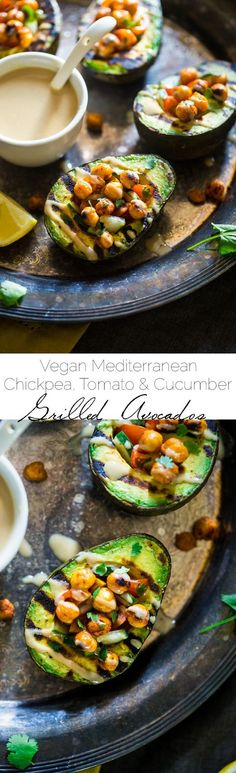 Vegan Mediterranean Chickpea Stuffed Grilled Avocado - Grilled avocado is stuffed with fresh cucumber, tomato and crispy grilled chickpeas! A drizzle of tahini makes this a delicious, healthy and easy, vegan dinner for under 250 calories! | http://Foodfaithfitness.com | @FoodFaithFit