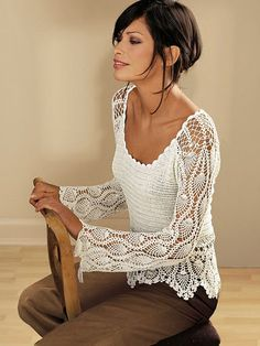 Crochet top with lovely sleeves - beautiful! Now to find someone to crochet for me :-)