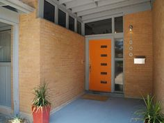 orange front door with orange brick