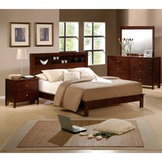 Spruce up the look of your bedroom with this queen-size four-piece bedroom set from Sonata. The set comes with a bed frame, dresser, mirror, and nightstand, all with a rich cherry finish. Each piece features clean lines and brushed silver hardware.