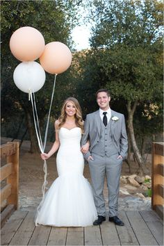 Bride and groom portraits with oversized balloons. Captured By: Alyssa Marie Photography ---> http://www.weddingchicks.com/2014/05/09/lucky-penny-wedding-tradition-you-will-love/