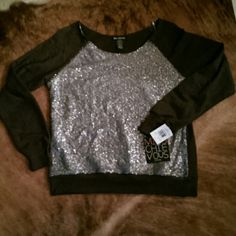 NWT..Lightweight sequin sweatshirt Beautiful black lightweight sweatshirt..with silver sequin embellishments covering front..made by miss chievous..sizeL miss chievous Tops Sweatshirts & Hoodies