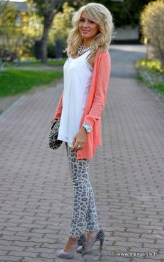 Coral cardigan and animal print jeans