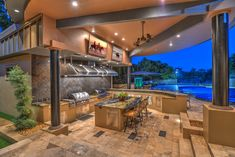 Contemporary Porch with Outdoor kitchen, Raised beds, Wrap around porch, exterior tile floors, Fence