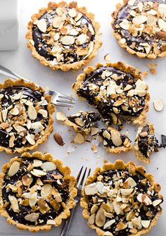 Gluten-Free Chocolate Almond Tartlets: almond flour and coconut crust filled with a creamy and rich chocolate ganache. Dairy and gluten-free!   TrufflesandTrends.com