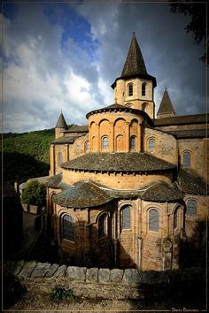 The Romanesque Abbey of Saint-Foy in Conques, France was an important stop on the medieval pilgrimage route and received rich gifts from pilgrims and kings. Romanesque Art, Romanesque Architecture, Religious Architecture, Art And Architecture, Sainte Foy De Conques, Places Around The World, Around The Worlds, Architecture Romane, Art Roman