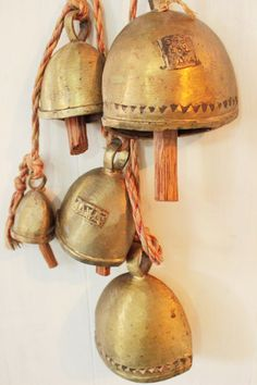 vintage #brass bells #Bali #Indonesian #bells with wood clappers - string of 5 by ninedoorsvintage on Etsy #vintage #vintagebrass #brassbells #brasschimes #chimes #homedecor #boho #bohemian #vintagebells #doorchime #doorbell #garden #java #asian #rustic #bohemia #bohodecor