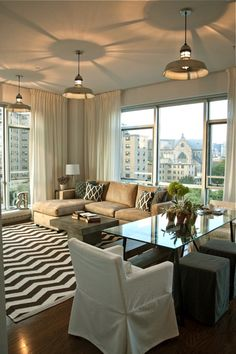 Stephanie Sabbe Boston Interior Designer, love the footstools for seating at the table!