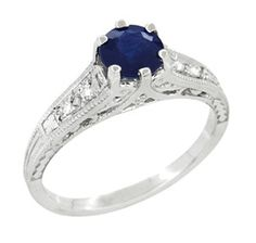 again, similar engagement ring. blue sapphire, white gold, filigree, diamonds