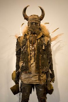 """In 2011, photographer Colby Vincent Edwards (in collaboration with William Franevsky and Jarrett Scherff) created The 8th Day, an incredible exhibition that """"documents"""" a post-apocalyptic future. In addition to black and white photography, the artists designed costumes made"""