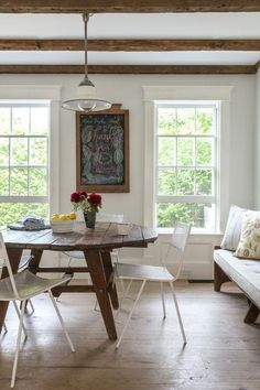 An antique table setup creates a rustic backdrop for hand-hewn Astier de Villatte dishware.