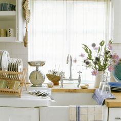 Kitchen sink with striped blind and seaside accessories