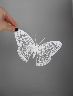 Intricate Butterfly Papercut Scherenschnitte in white. $30.00, via Etsy.