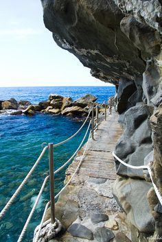 Riomaggiore, Cinque Terre, Italy - Narrow trail to the rocky beach.